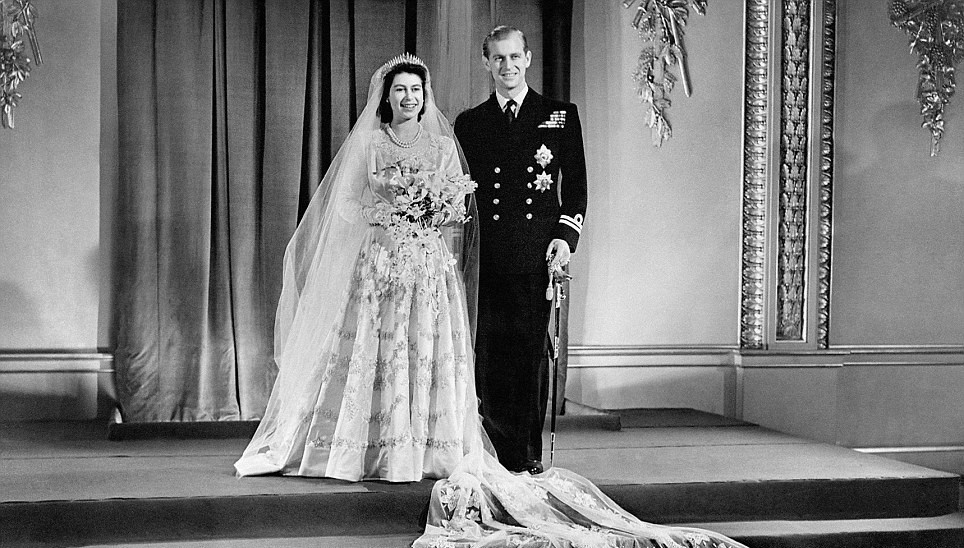 File photo dated 20/11/47 Princess Elizabeth and Lt Philip Mountbatten at Buckingham Palace after their wedding ceremony. PRESS ASSOCIATION Photo. Issue date: Monday November 19, 2012. The Queen and the Duke of Edinburgh celebrate their 65th wedding anniversary tomorrow. They will spend the day together privately at Buckingham Palace after an evening out at the Royal Variety Performance tonight. See PA story ROYAL Anniversary. Photo credit should read: PA Wire